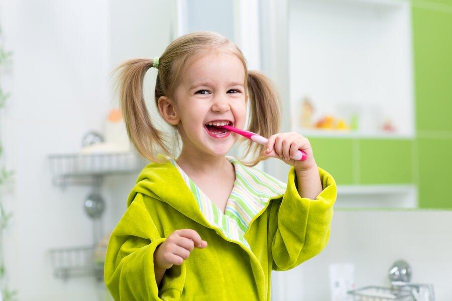 little girl brushing dental hygiene