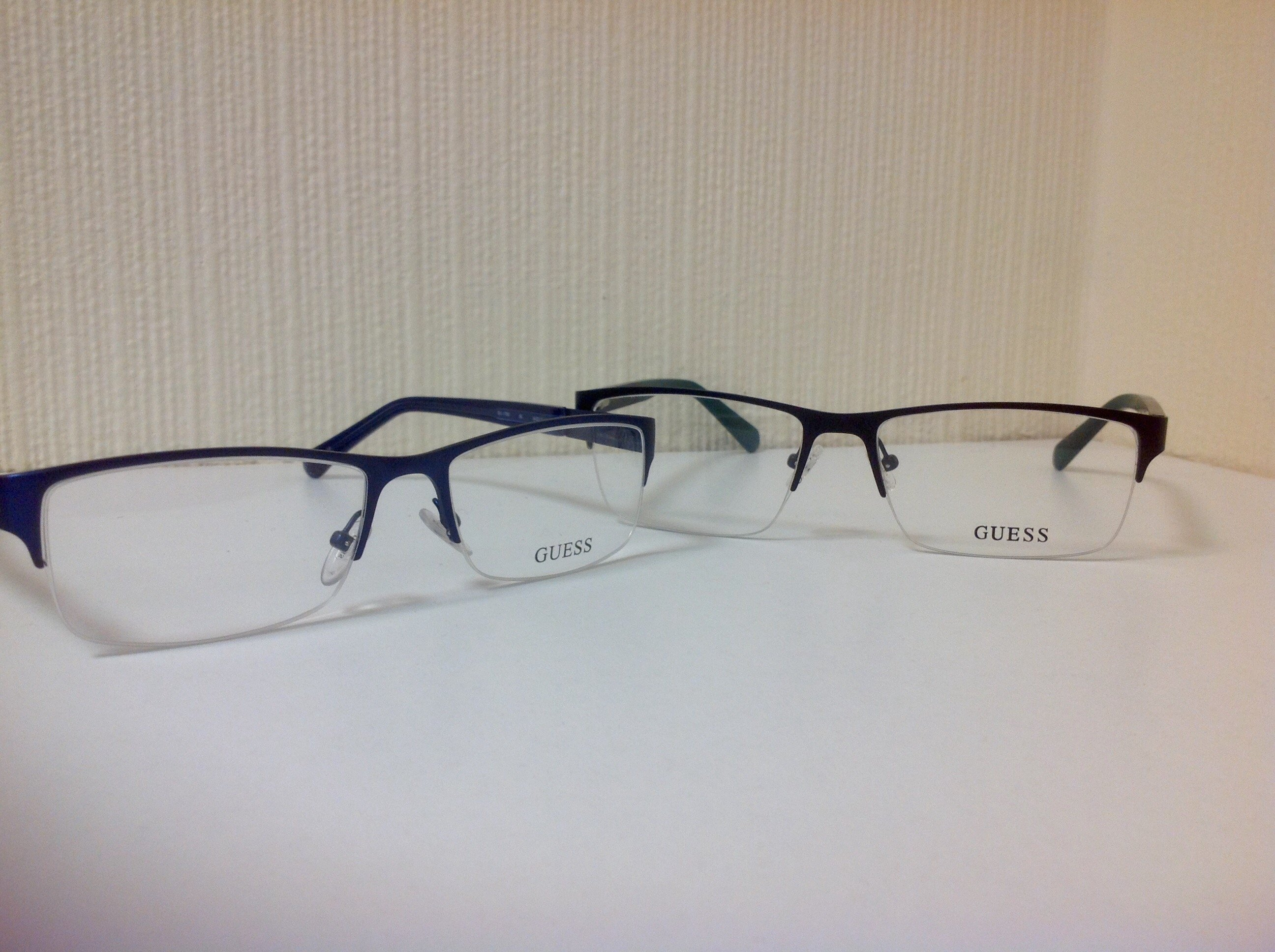 Half-rimmed Guess glasses
