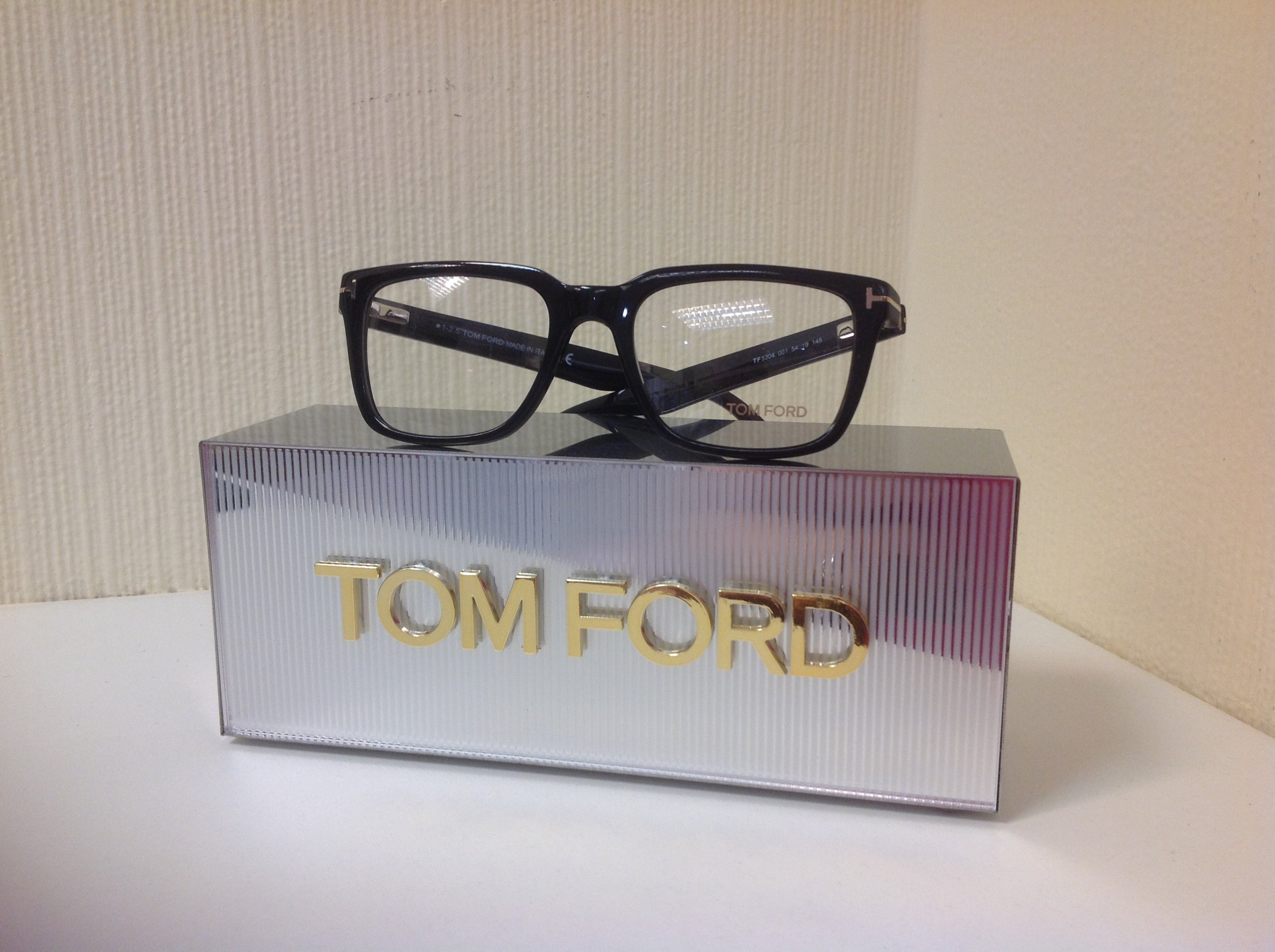 Dark-rimmed glasses by Tom Ford