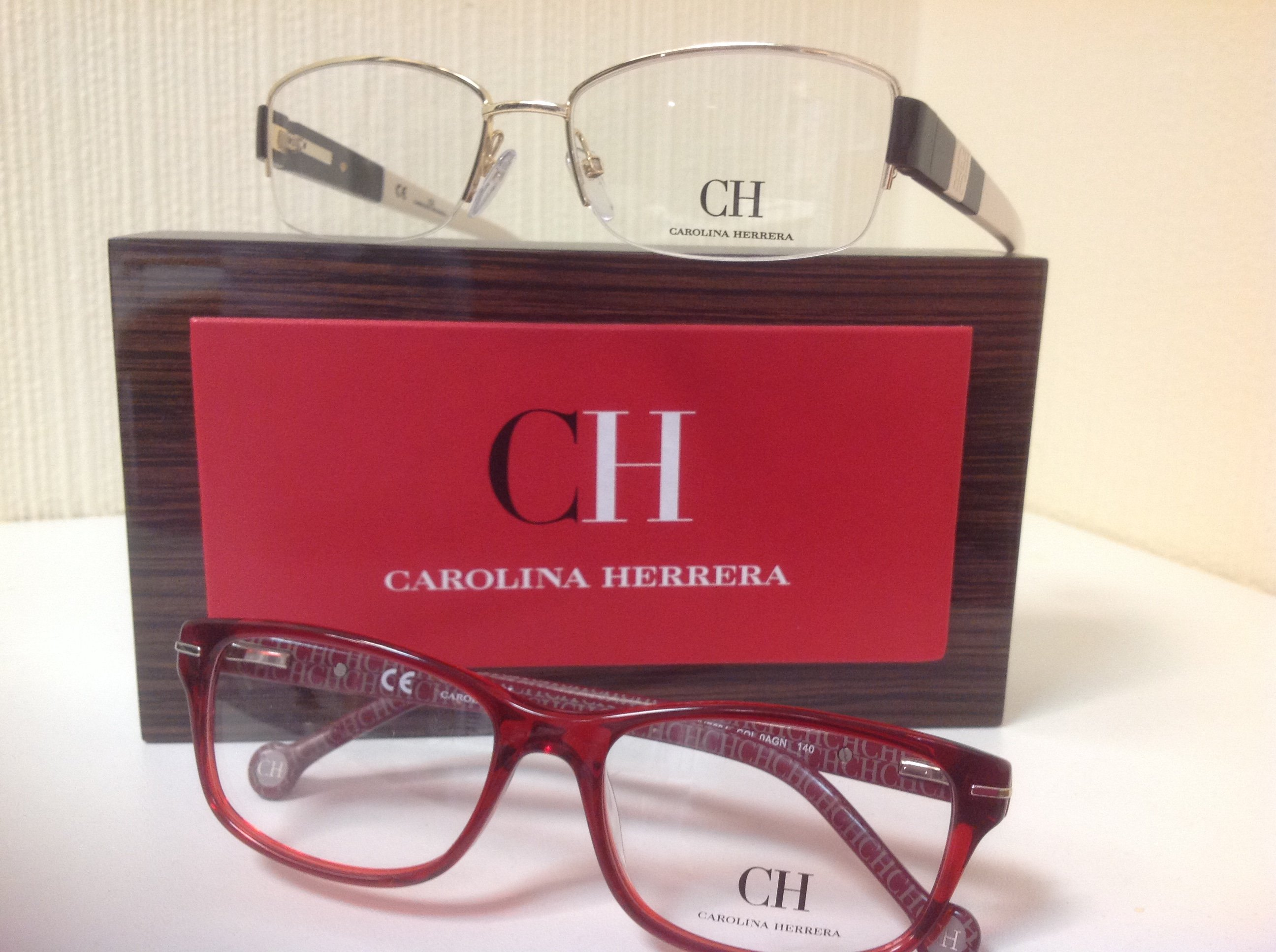 Gold- and red-framed glasses by Carolina Herrera