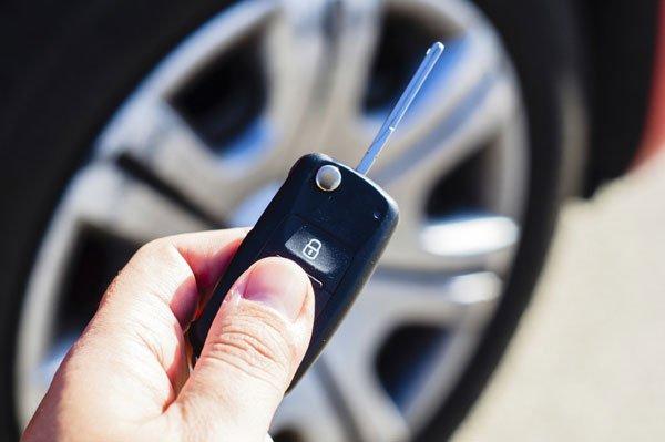 Satisfied customer with financed car keys