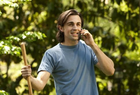 woodpecker tree services a person talking in mobile phone