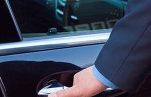 a man opening a taxi car door
