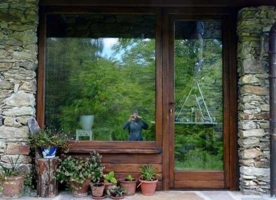 Portabalcone con finestra in legno