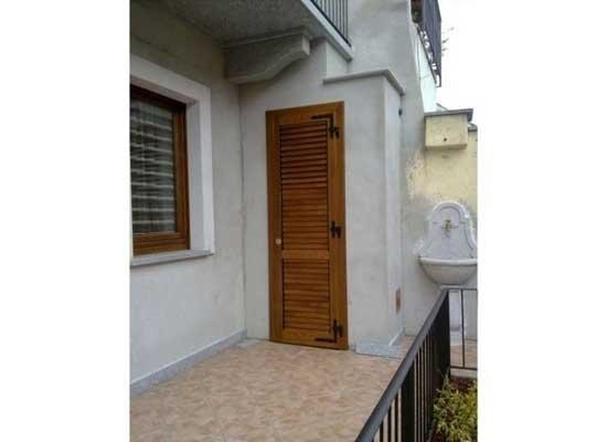 Antone in legno per porta balcone