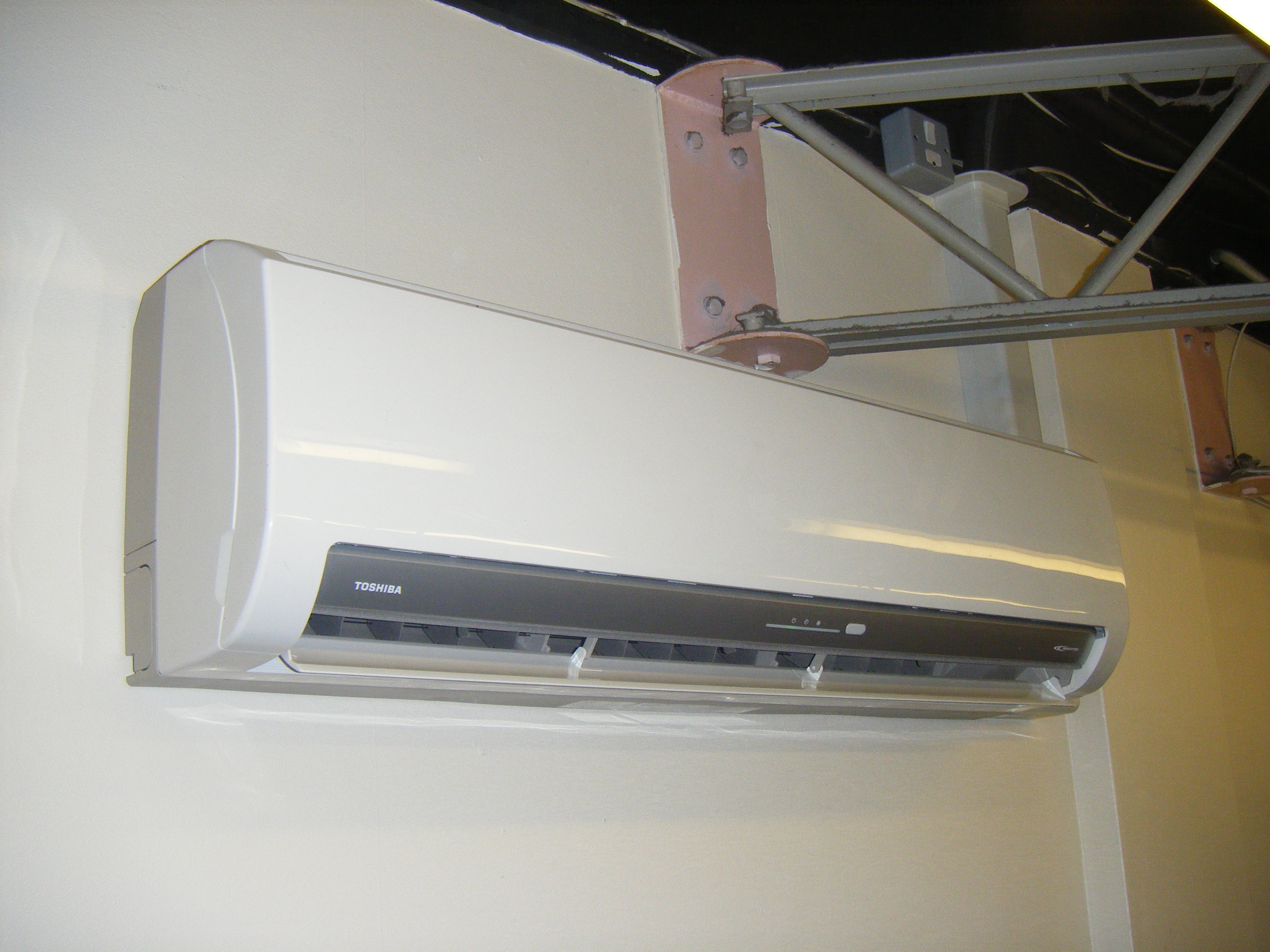 Wall mounted air conditioning unit installation