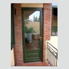 Porta realizzata con profilo alluminio-legno