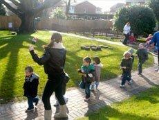 teacher helping kids play