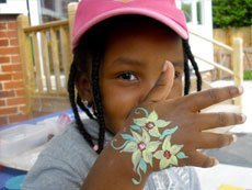 kid with hand paint