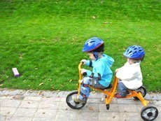 two kids on bicycle