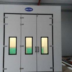 Exterior of a spray booth with bi-folding doors