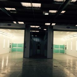 A single pit extraction spray booth from Haltec in the dark