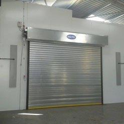 Spray booth from Haltec with a closed roller door