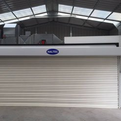 A Haltec spray booth with rolling doors