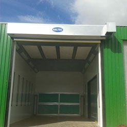A spray booth fitted outside with an open door