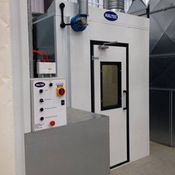 A spray booth with an emergency stop button for safety