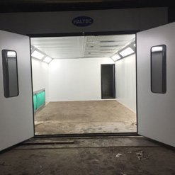Open doors on a HAltec spray booth showing the interior
