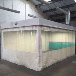 Flame retardant flexi curtains on an alloy wheel bay