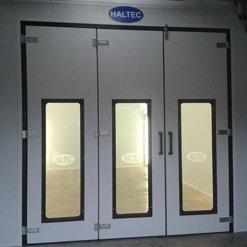 A closed, illuminated spray booth
