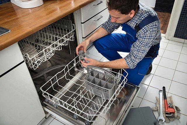 Nuttermans repair man repairing a dishwasher