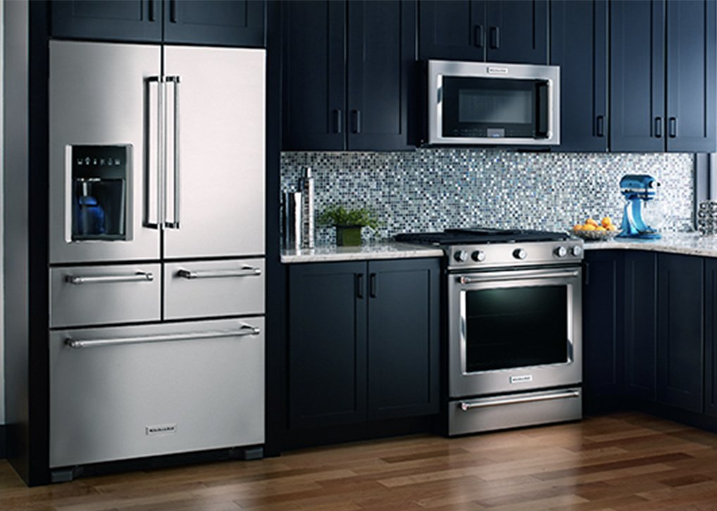 Stainless steel Kenmore appliances with modern black cabinets