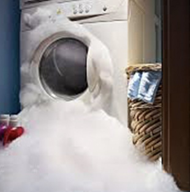 Washer over flowing with bubbles