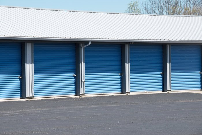 row of blue storage containers