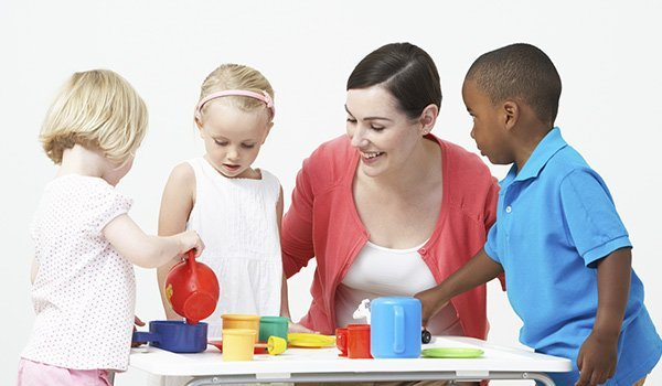 Tinkabell Learning Centre teacher playing with kids
