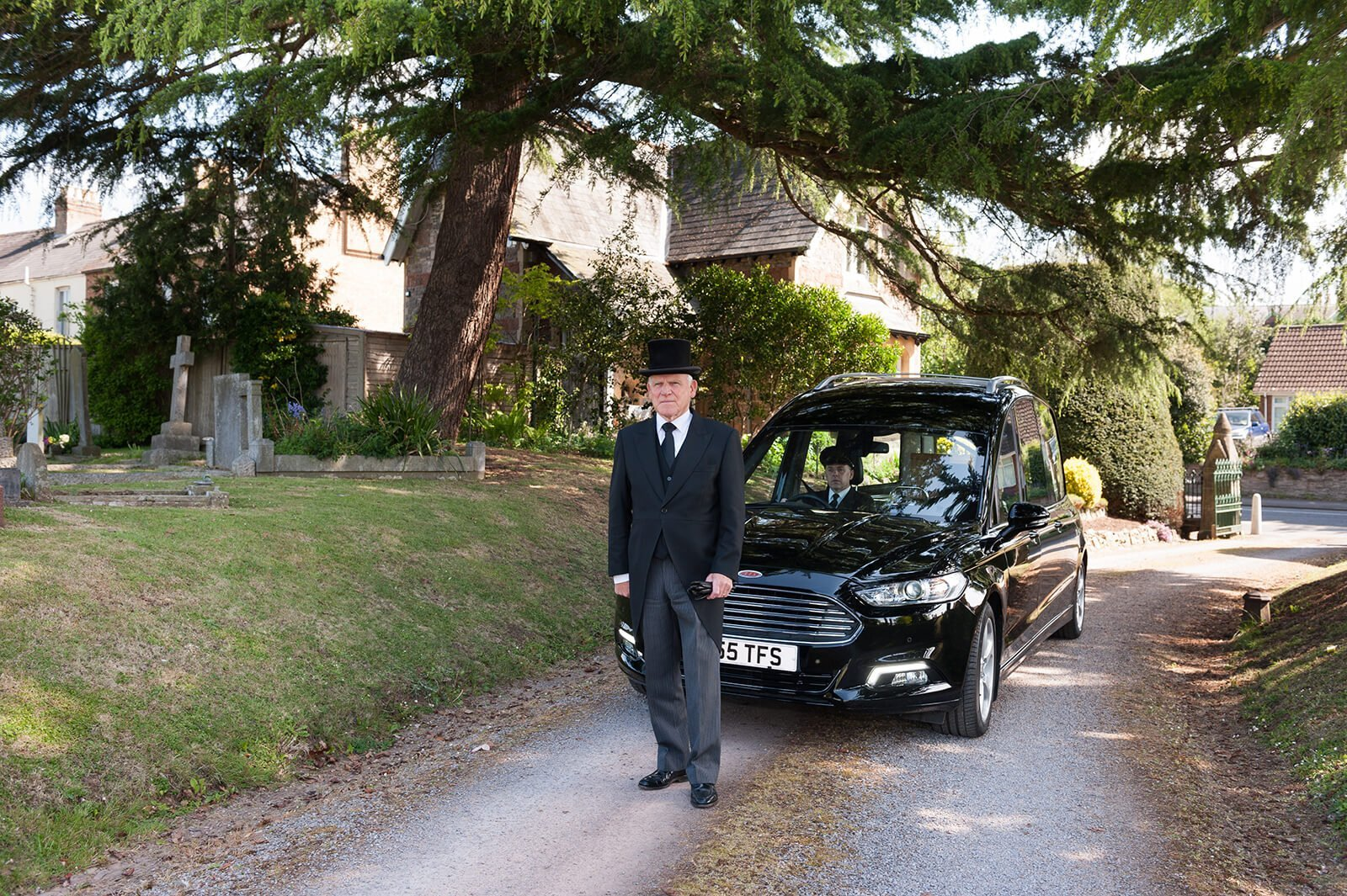 Man and funeral car