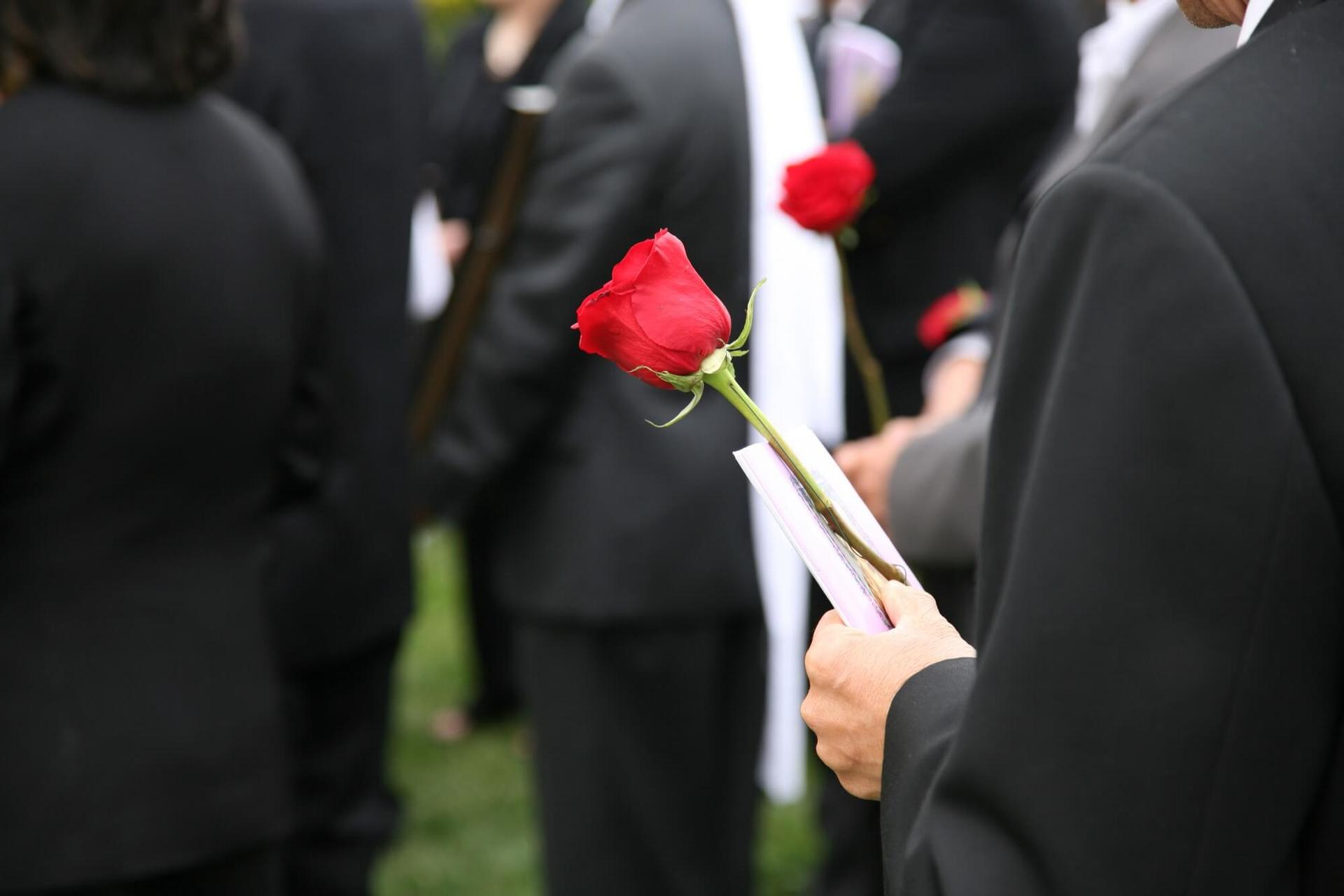 Close up rose during funeral service