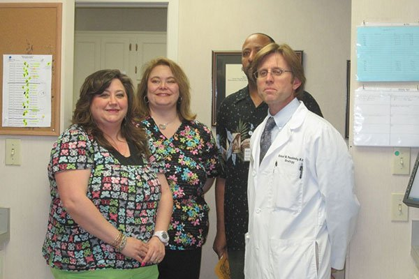 Dr. Puschinsky with staff