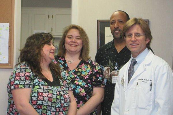 Dr. Richard W. Puschinsky with staff