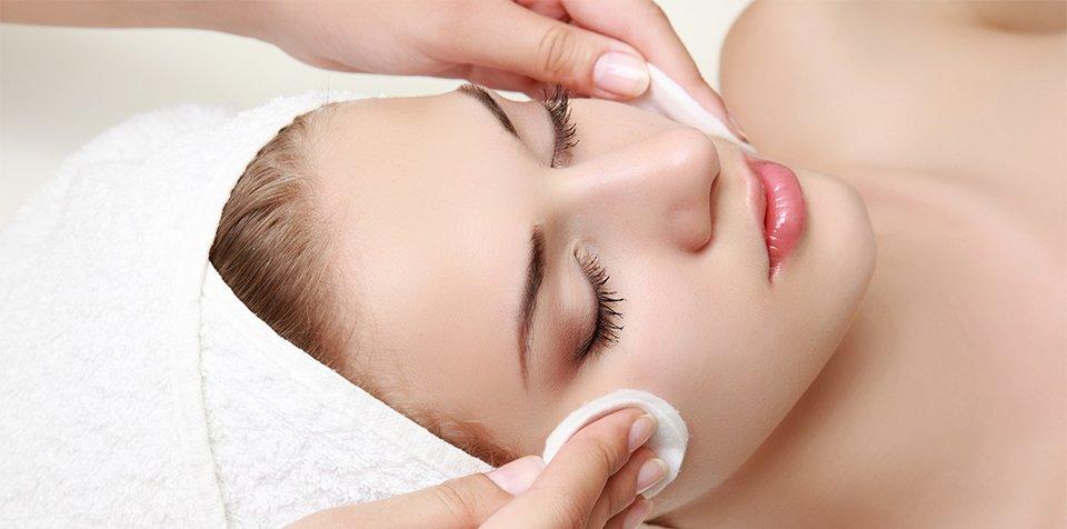 Skin cleansing woman having a facial
