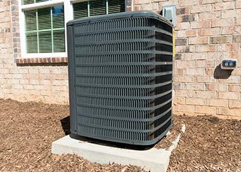 Large black air conditioner on outside of bilding