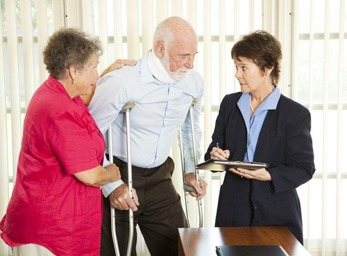Lawyer helping an old man in personal injury in Rochester, NY