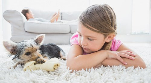 A girl and her puppy resting on our pet friendly flooring in Milton Keynes