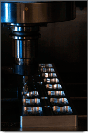 Precision holes being created in metal