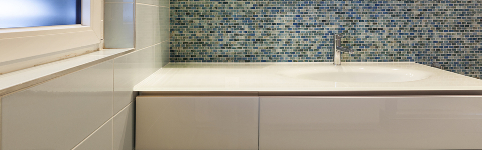 Renovated bathroom with blue ceramic tiles
