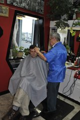 One of our barbers working with a happy customer in Anchorage, AK