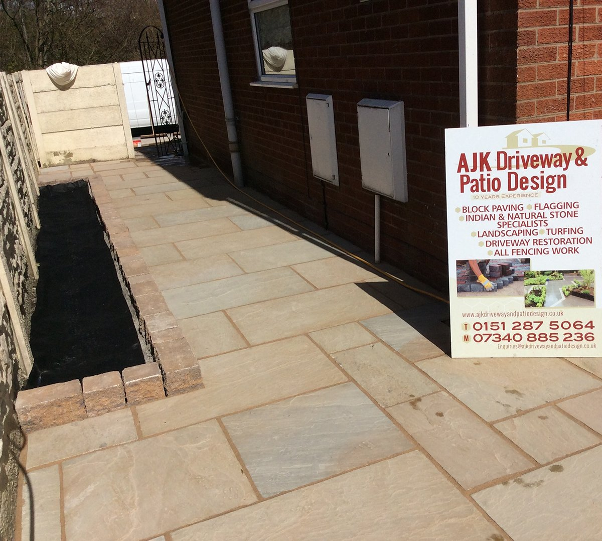 Natural stone paving side of house