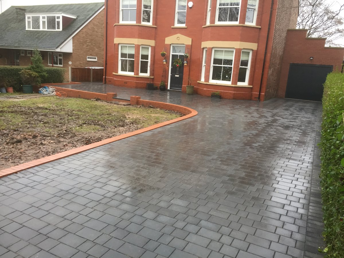 Block paving near red house