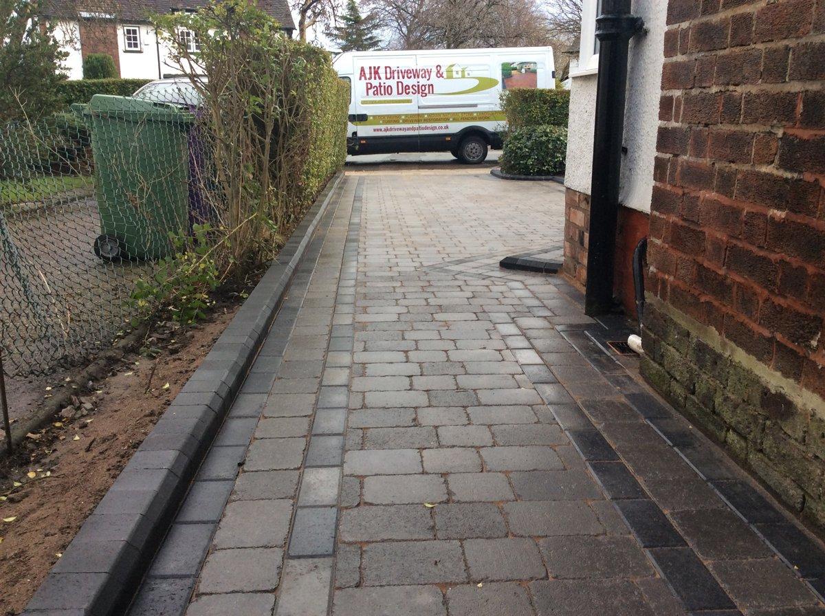 Long block paved driveway