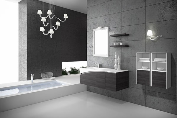 una vasca da bagno e sulla sinistra un lavabo e altri mobili da bagno