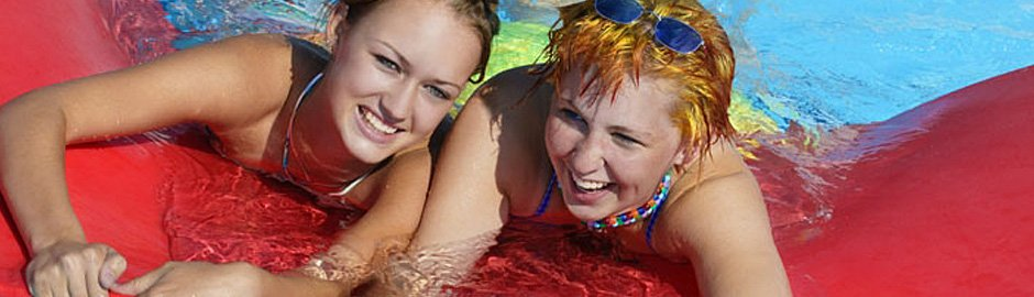 Friends laughing in swimming pool