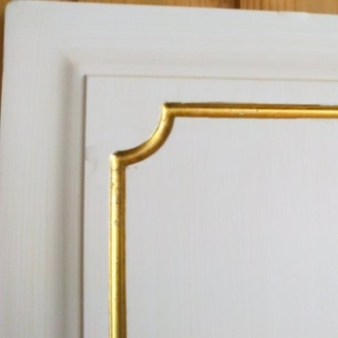 Riflessi oro su porta