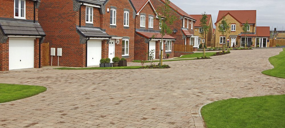 A housing development with a freshly laid road