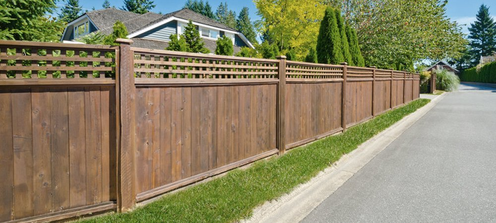 A tall wooden fence around a property