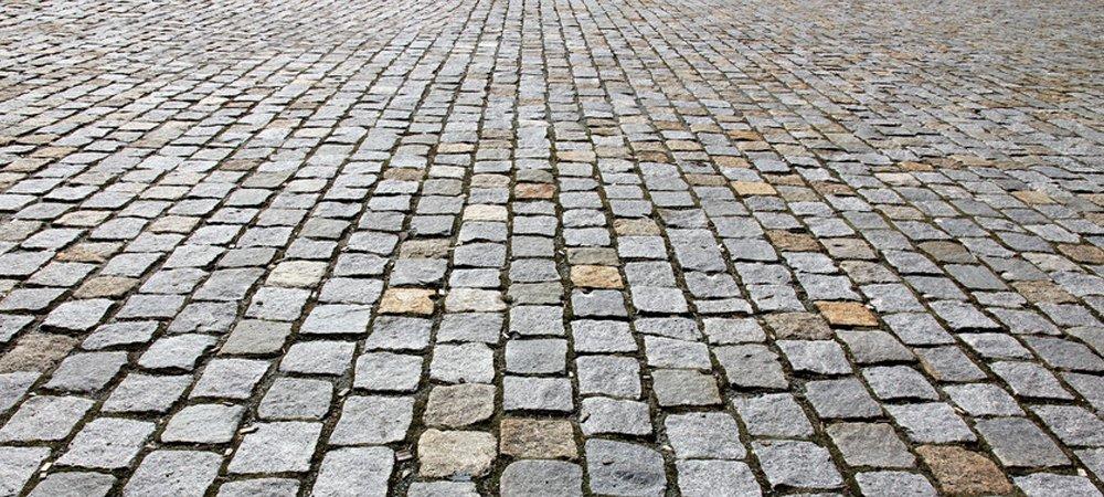 A close up of a cobbled road