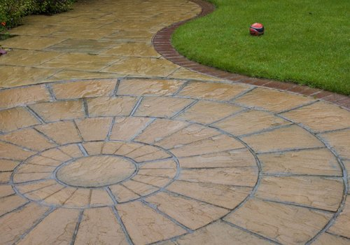 A patio with a circular pattern on it