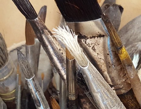 Brushes in a pot